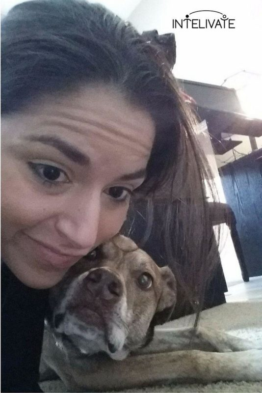 Leading Virtual and Remote Teams - Intelivate's Pamela Socorro poses with Kris Fannin's dog, Mercedes